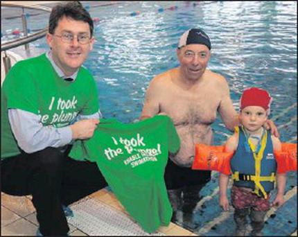 Sean Scally of Enable Ireland with Jim Litchfield and grandson Ben Litchfield from Leith, Tralee, launch the 4th annual swimathon in aid of the charity at the Manor West Hotel.