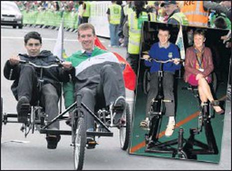 Castleisland Community College students, David O'Hanlon, Ballymacelligott and Pádraig Herlihy, Scartaglin parade their Kyoto Trike during the An Post RÁS Stage End celebrations in Castleisland on May 24-2011. Inset: Trike winner, Darragh Begley at the... Credit: Photos by John Reidy