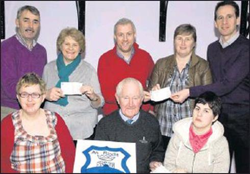 An Riocht AC members presenting €1,000 cheques to representatives of three local charities at the clubhouse. Included are, front from left: Margaret Enright, Oileán Beo; Denis Brosnan, An Riocht AC and Noreen McGuire, Olieán Beo. Back from left: Denis... Credit: Photo by John Reidy