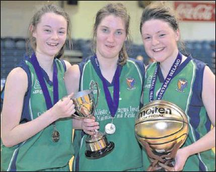 Colaiste Ide & Iosef Abbeyfeale co-captains with the cup, from left, Leanne Mangan, Sorcha McNulty and Eibhlis Dillon, who was also MVP, after their school's win in the All-Ireland U19 'A' Girls Cup Final at the National Basketball Arena, Tallaght,...