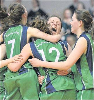 The players from Colaiste Ide & Iosef, Abbeyfeale, celebrate at the final buzzer after victory over Holy Faith Clontarf in the All-Ireland Schools Cup Under-19A Girls Final in the National Basketball Arena, Tallaght. Credit: Photo by Brendan Moran / SPORTSFILE