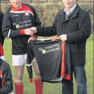Michael Moloney of Moloney Window Systems presenting new jerseys for the Raheen FC 'B' team to club Chairman James Furlong.