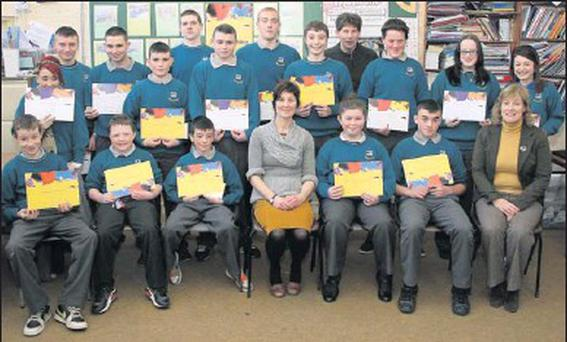 First and sixth year students in New Ross Vocational College who were presented with Paired Reading Certificates in the College last seen with teacher Grace Reddington (front centre), principal Sue Barrett (front right) and teacher Jim O'Connor (back).