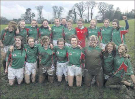 The mud was no deterrent to the Gorey Community School camogie team as they showed when they discarded their hurls and posed for the camera after winning their Leinster semi-final.