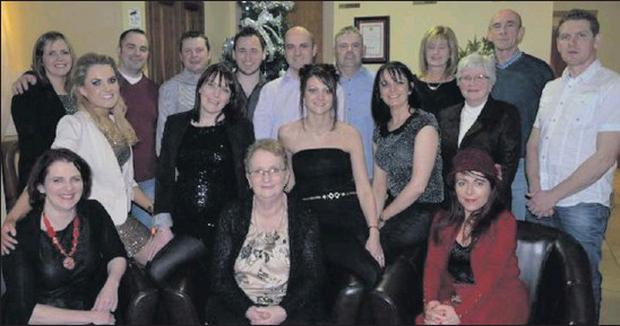 Tourlestrane's Ann Surlis pictured with her family on the occasion of her retirement from St Attracta's Nursing Home in the Gateway Hotel Swinford, recently. Ann was a long-serving member of staff, having 18 years service under her belt on her departure.