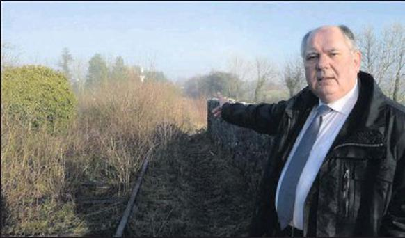 Don Dirrane of the Yeats County Inn, Curry, who is supporting the development of a Greenway on the Western Rail Corridor, points to the old railway track running behind the Yeats County Inn