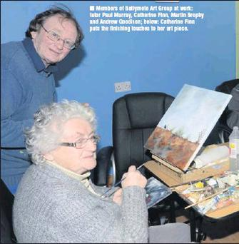 Members of Ballymote Art Group at work: tutor Paul Murray, Catherine Finn, Martin Brophy and Andrew Goodison; below: Catherine Finn puts the finishing touches to her art piece.