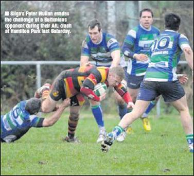 Sligo's Peter Mullan evades the challenge of a Suttonians opponent during their AIL clash at Hamilton Park last Saturday.