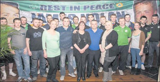 Jimmy and Essie Nolan with family and friends at the presentation of the James Nolan Flag in Murphy's, Blessington. Credit: Picturebybarryhamilton