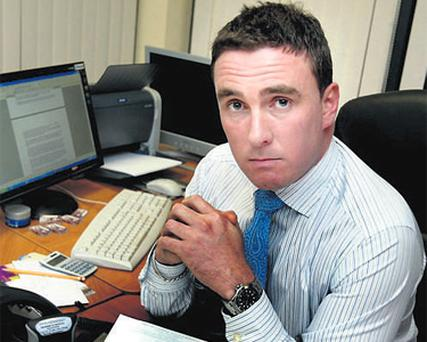 John Hennessy, the solicitor who acted for murder victim Baiba Saulite, at work in his office in Swords, Co Dublin