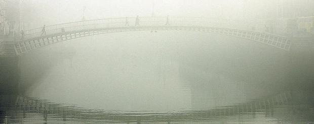 File phto shows Dublin's Ha'penny Bridge as heavy fog cloaked the capital