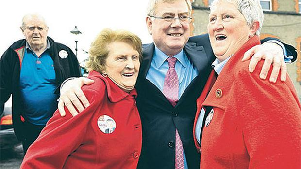 Eamon Gilmore canvassing in Thurles, Co Tipperary yesterday, with Theresa Lucas and Mary Vaughan