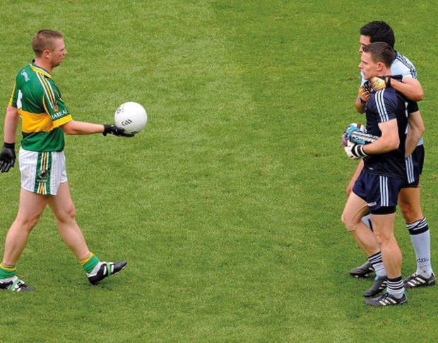 18 September 2011; Classy even in defeat. In a noble gesture Kerry defender Tomás Ó Sé hands the ball to match-winner Stephen Cluxton. Picture credit; Dáire Brennan / SPORTSFILE