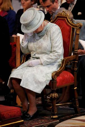 Queen Elizabeth wipes her eyes during a thanksgiving service to mark her Diamond Jubilee at St Paul's Cathedral