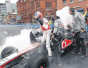 Jenson Button leaves his car to his team after the demo on the streets of Dublin yesterday.