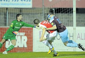 Drogheda's Gavin Brennan heads in a goal which was subsequently disallowed