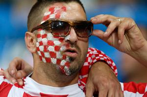 An Croatian fan adjusts his sunglasses