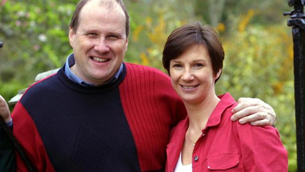 Ivan Yates and his wife Deirdre pictured in 2002. Yates's back pain means he often has to lie down while being driven by his wife