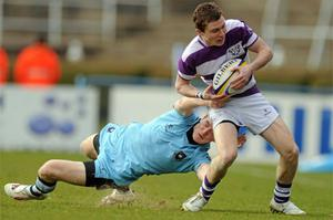 Aaron Thompson of Clongowes is tackled by St Michael's Mark  Corballis in last year's Leinster Schools Senior Cup final.