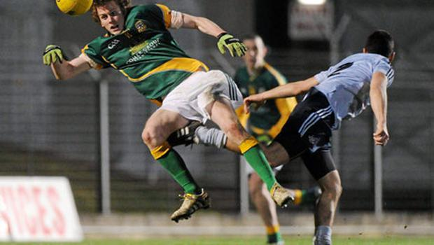 Meath's Darragh Smith in action against Kevin O'Brien of Dublin during the Leinster U-21 Football Championship match in Navan last night. Photo: Brian Lawless / Sportsfile