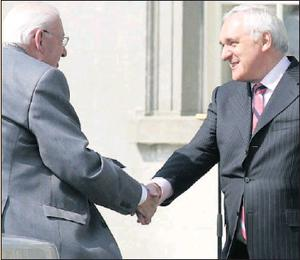 You are welcome, Rev Ian Paisley and Taoiseach Bertie Ahern at the Oldbridge Estate.