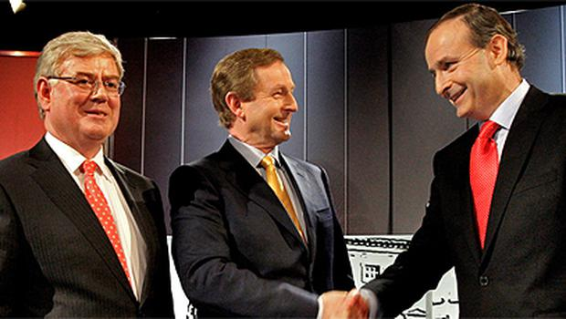 Eamon Gilmore, Enda Kenny and Micheal Martin greet eachother in TG4's studio before yesterday's debate