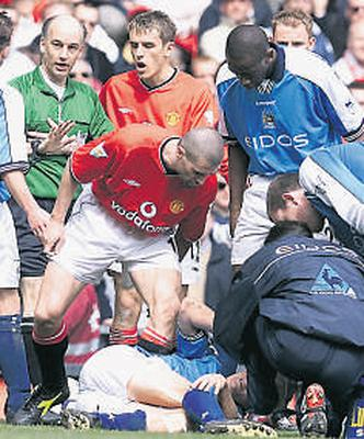 Keane has a word with Alf Inge Haaland; in his autobiography Keane admitted he deliberately injured the Manchester City player