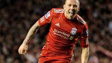 Craig Bellamy celebrates scoring Liverpool's second goal during the Carling Cup semi-final second leg match against Manchester City at Anfield last night