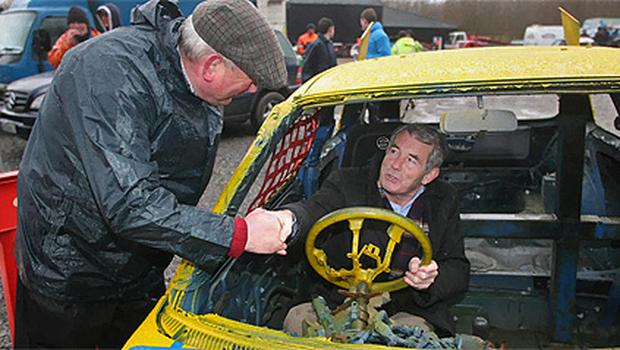 Michael Lowry shakes hands with event organiser John Joe Patterson while canvassing at the Hot Rod Track near Dunkerrin, North Tipperary