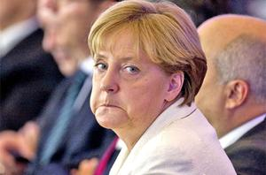 Angela Merkel is still struggling to persuade her ruling coalition to vote in favour an extension of powers for the eurozone's financial rescue fund. photo: Getty Images