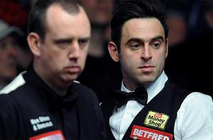 Ronnie O'Sullivan (right) and Mark Williams during the Betfred.com World Snooker Championships at the Crucible Theatre, Sheffield. Photo: PA