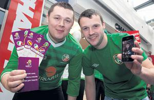 Kieran Hulsman hands the lost tickets to Ronan Davis for Damian Coughlan (in photo on the phone).