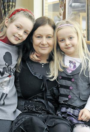 Big is good: Marie Byrne with her daughters Rachel (9) and Jennifer (6). Photo: Dave Meehan