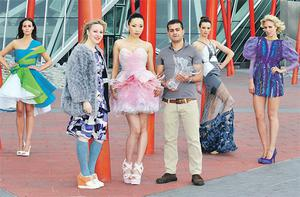 Designer Joanne Hynes (second left) with Umit Kutluk and model Yomiko wearing his winning design. Other entries are modelled by Jane Wilde, Karen Fitzpatrick and Jude Nabney. BRIAN MCEVOY