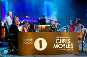 Handout photo issued by BBC Radio 1 of Chris Moyles (left) and the team hosting his penultimate breakfast slot in front of 200-plus listeners at the BBC's Radio Theatre. PRESS ASSOCIATION Photo. Issue date: Thursday September 13, 2012. Moyles, 38, was welcoming a series of special guests on the show and his team presented a series of video montages looking back at his period of more than eight years in charge of the prestige morning show. See PA story SHOWBIZ Moyles. Photo credit should read: Tom Howard/BBC/PA Wire NOTE TO EDITORS: This handout photo may only be used in for editorial reporting purposes for the contemporaneous illustration of events, things or the people in the image or facts mentioned in the caption. Reuse of the picture may require further permission from the copyright holder.