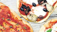 Classics: (clockwise from top right), the Capricciosa, the Margherita and the Marinara