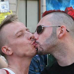 The majority of white undergraduate men are happy to kiss another man on the lips, a survey has found