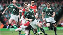Robert Kearney (left) getting up in support of Gordon D'Arcy as he makes a break during Ireland's historic win over Wales at the Millennium Stadium, Cardiff, last Saturday to clinch the first Grand Slam since 1948 and the Triple Crown. On the right is...