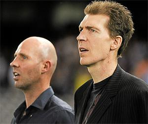 Jim Stynes and his brother Brian, left, during  the National Anthems at the International Rules series in Melbourne in October 2011