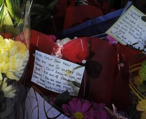 Floral tributes left near the scene. Photo: PA