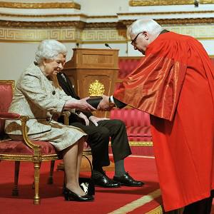 The Queen receives a copy of the loyal address from the Chancellor of Oxford University Lord Patten