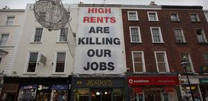 A giant billboard calls for lower rents in Grafton Street on December 2, 2010 in Dublin, Ireland. Photo: Getty Images