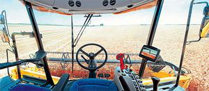 The new interior cab design features seat armrest-mounted Command Grip, a multifunction control handle, incorporating header, unloading and forward speed controls, and the IntelliView III colour touchscreen monitor displays all necessary machine functions