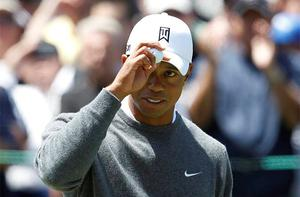 Tiger Woods reacts after his birdie on the fifth hole. Photo: Reuters