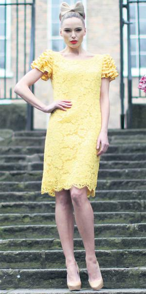 Sarah Morrissey in the yellow lace 'Juliette' dress (€1,695)  from Louise Kennedy's spring summer collection. LEON FARRELL/PHOTOCALL IRELAND