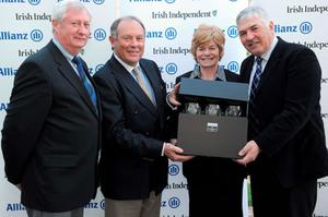 Donal Bollard of Allianz (2nd left) presents second prize to the Beech Park team of Eamonn Burke, captain (L), Noeleen O Brien, lady captain and Noel Frazer, hon treasurer at Portmarnock Hotel and Golf Links.