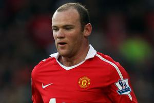 Carlos Tevez believes Wayne Rooney will help them win everything. Photo: Getty Images