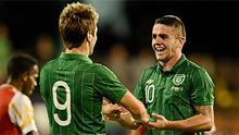 Kevin Doyle (left) celebrates with Robbie Brady after scoring Ireland's third goal against Oman