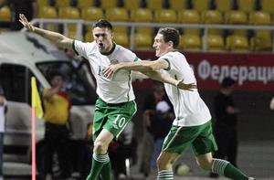 Ireland's two-goal here Robbie Keane celebrates with Keith Andrews at the Philip II Arena in Skopje last night. Photo: Niall Carson