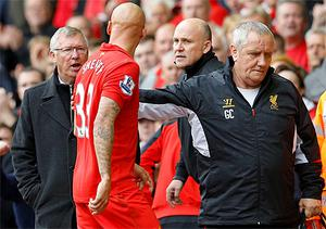 Jonjo Shelvey argues with Manchester United manager Alex Ferguson after being sent off